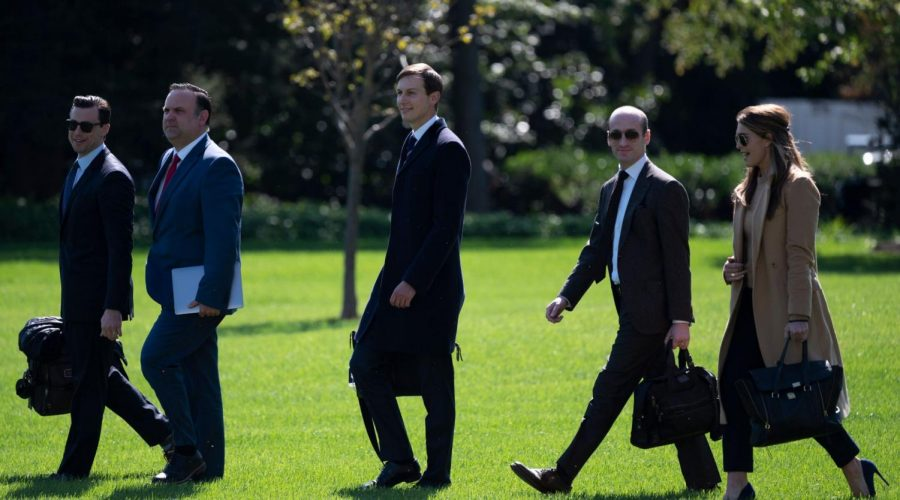 Jared Kushner (third from right), Stephen Miller (second from right) and Trump advisor Hope Hicks walk to Marine One on the White House lawn Sept. 30, 2020. Hicks began showing symptoms of COVID-19 that day. (Andrew Caballero-Reynolds/AFP via Getty Images)
