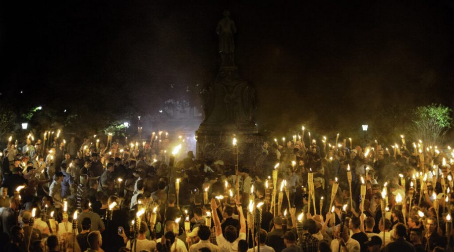 Neo+Nazis%2C+Alt-Right%2C+and+White+Supremacists+encircle+counter+protestors+at+the+base+of+a+statue+of+Thomas+Jefferson+after+marching+through+the+University+of+Virginia+campus+with+torches+in+Charlottesville%2C+Va.%2C+USA+on+August+11%2C+2017.+%28Photo+by+Shay+Horse%2FNurPhoto+via+Getty+Images%29