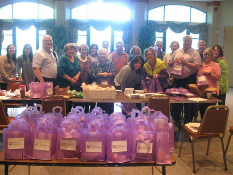 Volunteers came together at a gift packing event for Shomrei Amoonim with a group of B'nai Amoona members.