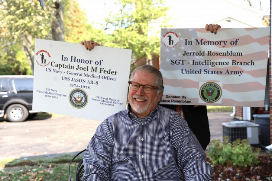 Steve Rosenblum is shown with signs from The Kaufman Fund golf tournament, which he helps arrange. Rosenblum is a board member of The Kaufman Fund, an organization that works to assist veterans. Photo: Bill Motchan