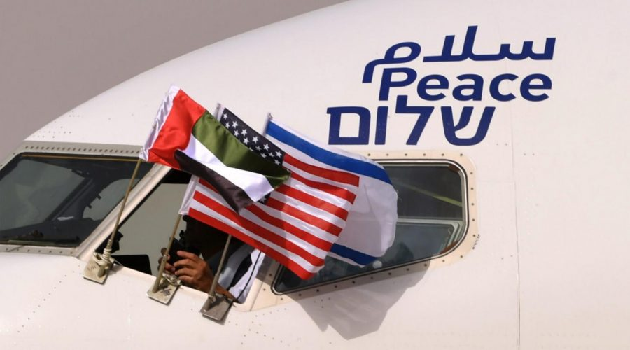 An+El+Al+plane+flying+the+flags+of+Israel%2C+the+United+Arab+Emirates+and+the+United+States%2C+and+bearing+the+word+%22peace%22+in+Arabic%2C+English+and+Hebrew%2C+arrives+at+the+Abu+Dhabi+airport+from+Tel+Aviv%2C+Aug.+31%2C+2020.+%28Karim+Sahib%2FAFP+via+Getty+Images%29