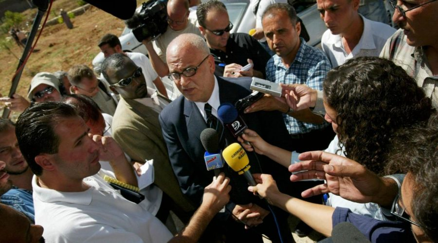 Palestinian Authority parliment member Saeb Erekat, chief negotiator with Arafat talks with the press before a meeting at the Palestinian parliament in Ramallah, West Bank on September 6, 2003. (Photo by Paula Bronstein/ Getty Images)