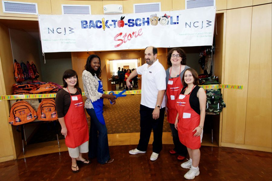 Cutting the ribbon at the 2006 Back to School! Store at Central Reform Congregation are (from left) Anna Poger, committee co-chair, Spring Glover (wife of then-St. Louis Rams player La'Roi Glover), Paul Harris of KMOX, and Dana Gaby and Melissa Baris, both committee co-chairs.File photo: Lisa Mandel