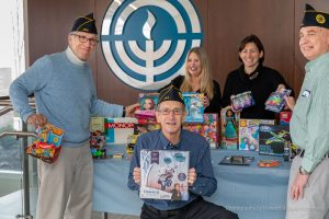 In this file photo, Jewish War Veterans Post 644 donates toys the organization collected  to the Hanukkah Hugs program organized by Women's Philanthropy and Jewish Family Services. Pictured here are Harvey Bloth, Howard Holtzman, Pam Super, Lauren Gelber and Larry Chervitz. Photo: Howard Holtzman