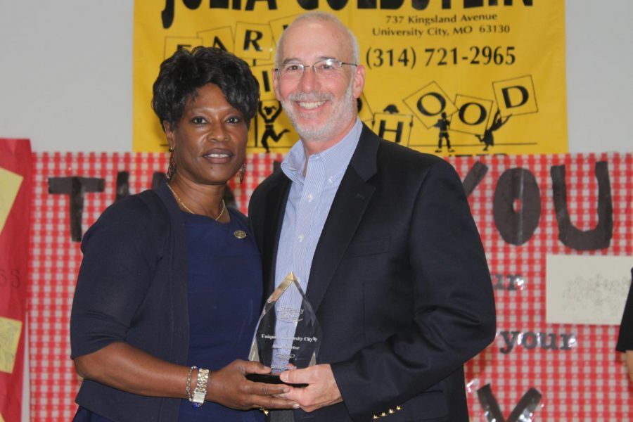 Alan Spector receives the Uniquely U City award from Superintendent Joylynn Pruitt for having initiated a life planning program at U. City High School.