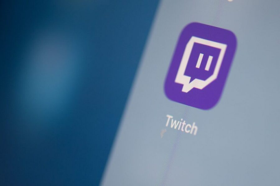 The streaming video platform Twitch logo can be seen on a tablet screen in July 2019. Photo: Martin Bureau/AFP via Getty Images