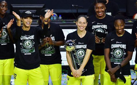 PALMETTO, FLORIDA - OCTOBER 06: Sue Bird #10 of the Seattle Storm holds on to the WNBA Championship Trophy after defeating the Las Vegas Aces 92-59 in Game 3 of the WNBA Finals at Feld Entertainment Center on October 06, 2020 in Palmetto, Florida. NOTE TO USER: User expressly acknowledges and agrees that, by downloading and or using this photograph, User is consenting to the terms and conditions of the Getty Images License Agreement. (Photo by Julio Aguilar/Getty Images)