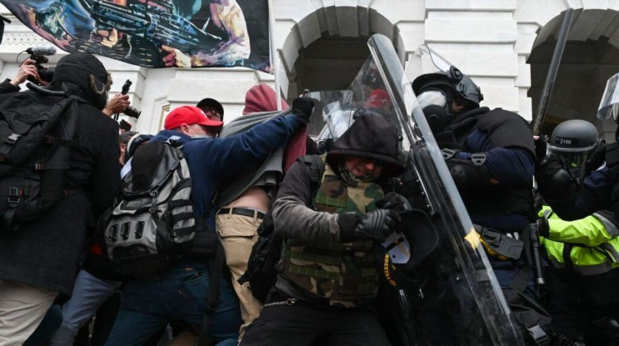 Riot police push back a crowd of supporters of US President Donald Trump after they stormed the Capitol building in Washington, DC on Jan. 6, 2021. (Roberto Schmidt AFP via Getty Images)