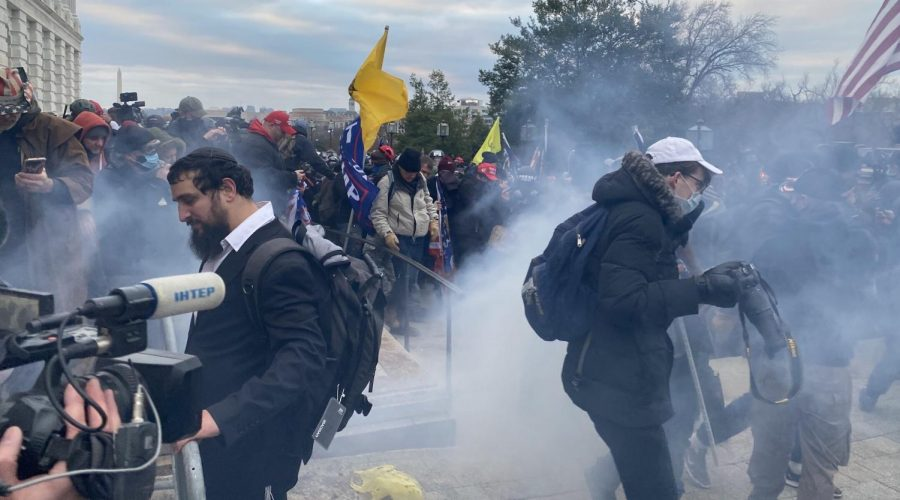 Security forces respond with tear gas after the US President Donald Trumps supporters breached the US Capitol security in Washington D.C. on January 6, 2021. (Tayfun Coskun/Anadolu Agency via Getty Images)