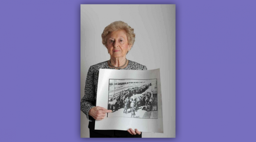 Irene Fogel Weiss points to a photo of herself upon arrival in Auschwitz in May 1944. (Lesley Weiss)