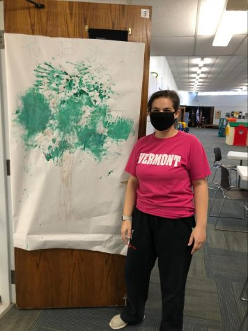 Paige Rubin displays her preschool students' artwork on her classroom door.