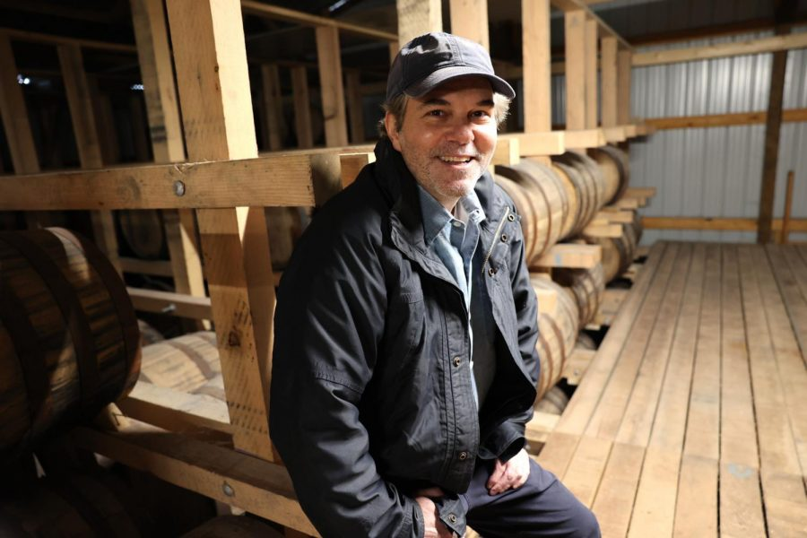 David Hermelin is shown with the barrels used to age Hermelins Righteous Seven Barrel Reserve liqueur. Photo: Bill Motchan