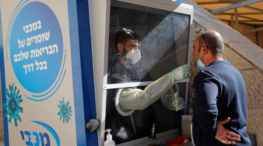 A medical worker swabs a patient in Modiin on Dec. 27, 2020, as Israel entered its third lockdown. (Xinhua/Gil Cohen Magen via Getty Images)