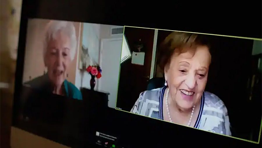Betty Grebenschikoff, left, reunites with Ana María Wahrenberg on a Zoom call. Both Holocaust survivors are now 91. (Courtesy of USC Shoah Foundation)