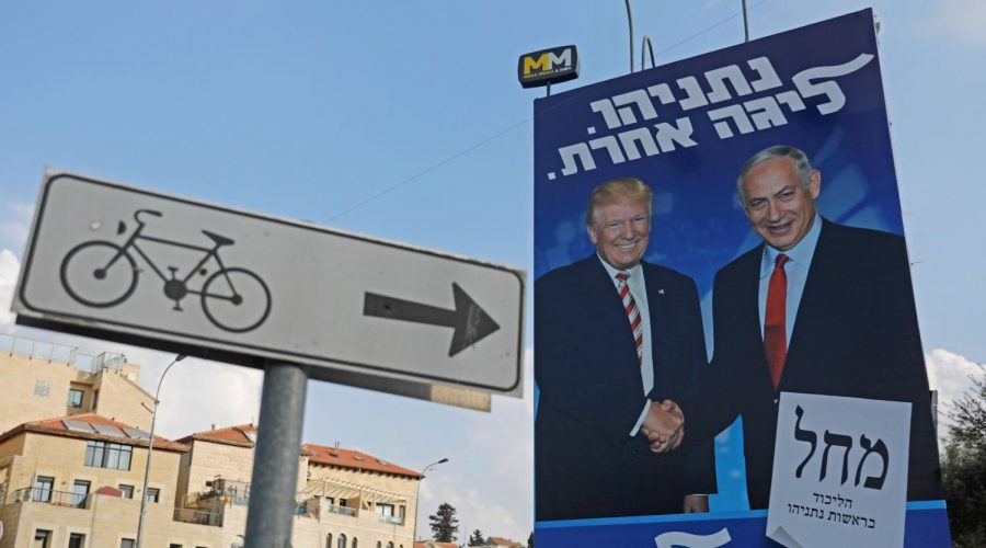 A previous Israeli election billboard in Jerusalem for the Likud party shows President Donald Trump shaking hands with Prime Minister Benjamin Netanyahu, also the Likud party chairman, Sept. 16, 2019. (Ahmad Gharabli/AFP/Getty Images)