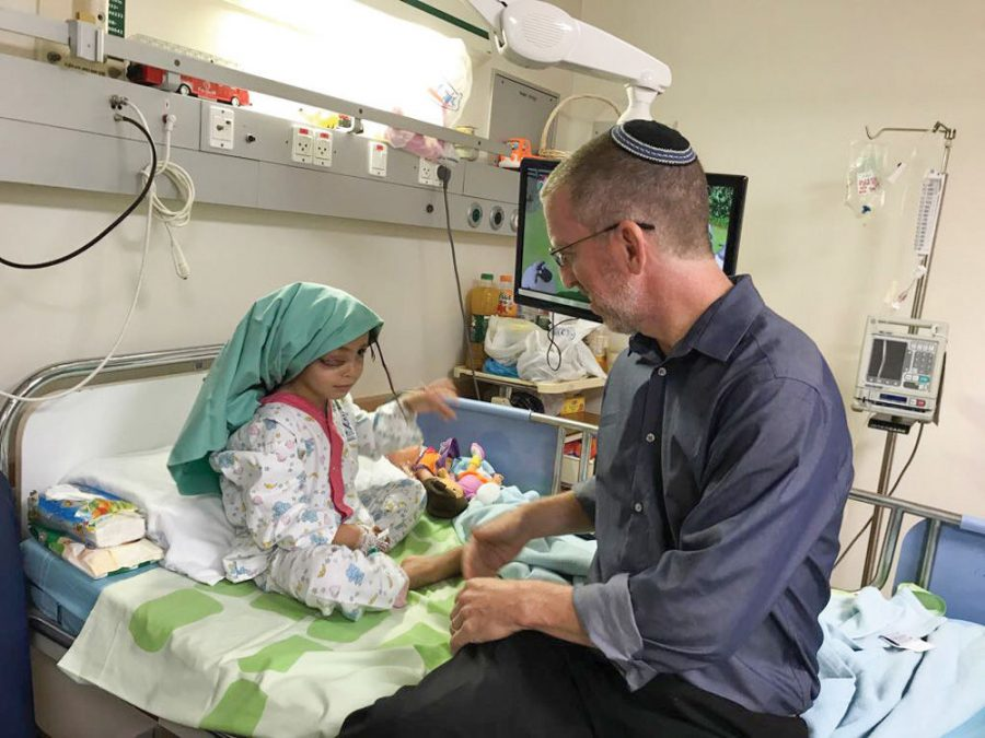 Dr. Morris Hartstein treats a Palestinian girl from Gaza with alymphatic malformation in one of her eyes.She received treatment in an Israeli hospital. Courtesy of Hartstein