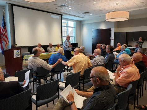 Harvey Gerstein speaks in September 2019 at the Mirowitz Center during a kickoff event for Friends Enjoying Life, a group Gerstein formed to provide social opportunities for active senior men.
