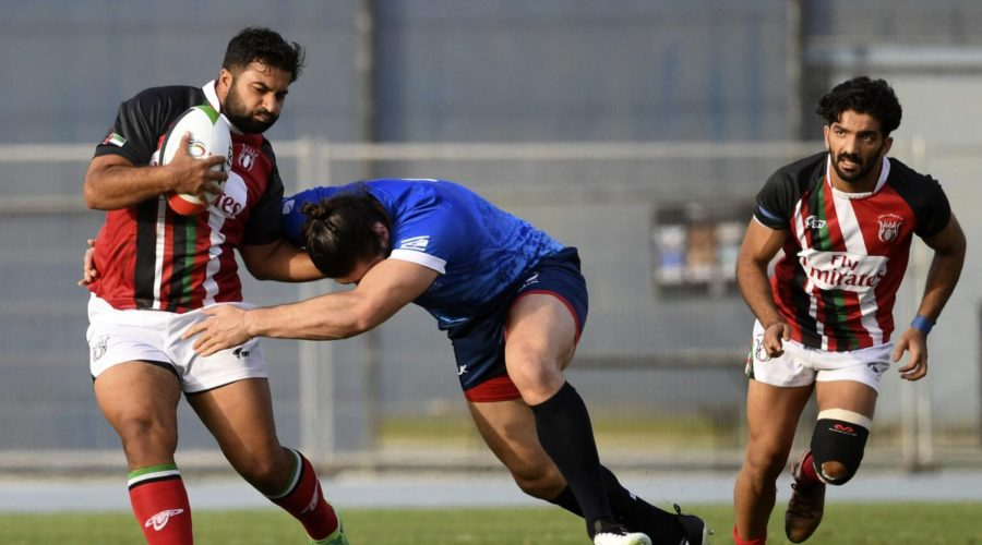 Israel's Uri Gail, center, in action during a rugby match against the United Arab Emirates national team in Dubai, March 19, 2021. (Karim Sahib/AFP via Getty Images)