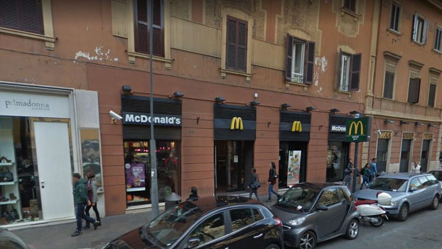 Pedestrians walk past the McDonald's restaurant on Piazza Re di Roma in Rome, Italy in 2015. (Google Street View)