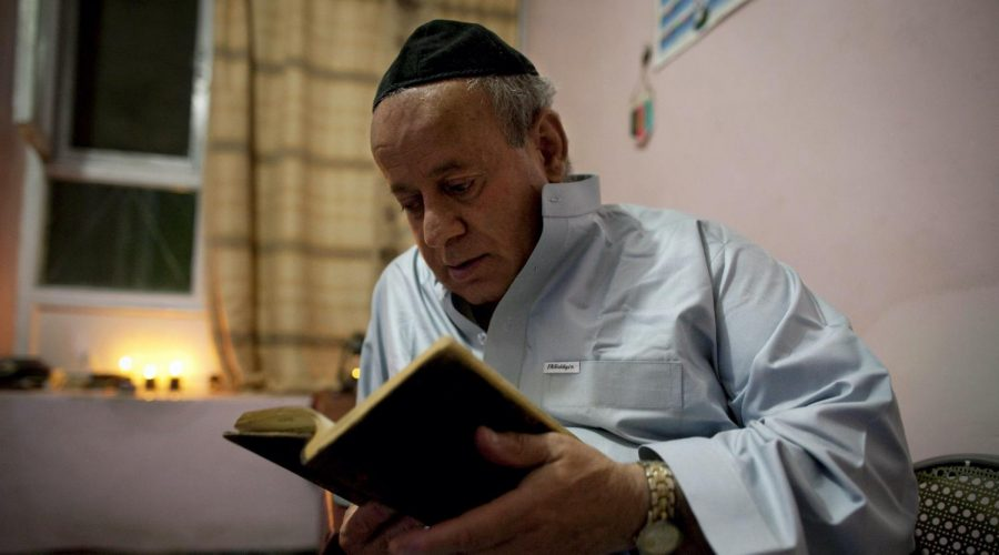 KABUL%2C+AFGHANISTAN+-+SEPTEMBER+18%3A+Zebulon+Simantov+reads+his+old+tatered+hebrew+prayer+book+as+he+celebrates+the+Jewish+New+Year+feast+of+Rosh+Hashanah+September+18%2C+2009+in+Kabul%2C+Afghanistan.+Zebulon%2C+57%2C+claims+to+be+the+last+Jew+living+in+the+war-torn+conservative+Muslim+country+and+says+he+keeps+a+Kosher+home.+The+Jewish+New+Year%2C+or+Rosh+Hashanah%2C+coincides+this+year+with+Eid+al-Fitr%2C+a+Muslim+feast+marking+the+end+of+the+fasting+month+of+Ramadan.+Born+in+northwestern+Herat%2C+Simantov+attended+Hebrew+school+before+moving+to+Kabul+at+age+27.+In+1992%2C+he+fled+to+Tajikistan%2C+fleeing+from+Afghanistans+growing+violence%2C+married+a+Tajik+Jew+and+had+two+daughters.+The+family+immigrated+in+1998+to+Israel%2C+but+he+returned+to+Kabul+two+months+later%2C+leaving+them+behind.+%28Photo+by+Paula+Bronstein%2FGetty+Images%29