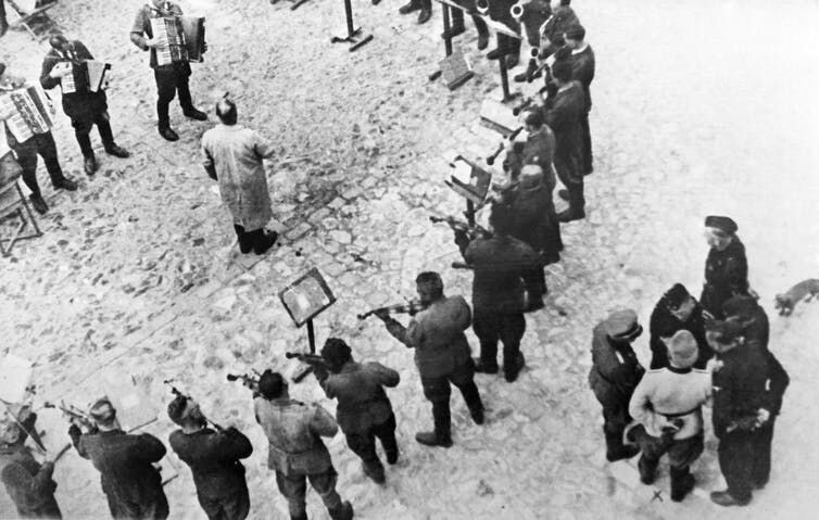 Prisoners play 'The Tango of Death' during the execution of Soviet citizens at the Janowska concentration camp in Ukraine.AFP via Getty Images