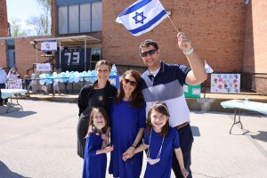 Epstein Hebrew Academy celebrated the completion of a Hebrew learning  project on Yom Ha'atzmaut, Israel Independence Day. Pictured here are Dalia Oppenheimer with her mother Zakeie Oppenheimer and her brother Max Opppenheimer, and first-graders Yaffa Globower and Maya Oppenheimer.