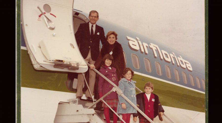 Eli+Timoner+stands+with+his+family%2C+including+future+rabbi+Rachel+Timoner%2C+on+a+plane+from+the+airline+he+founded.+%28Courtesy+of+Rachel+Timoner%29%0A