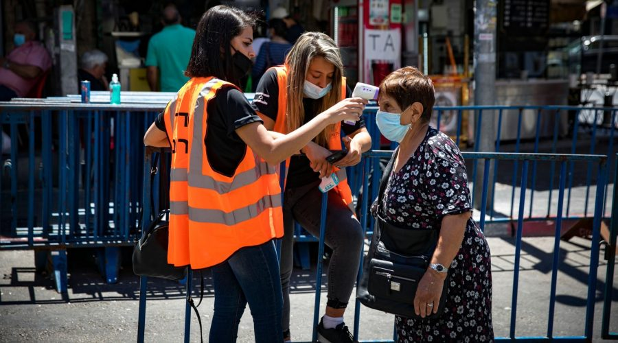 An+Israeli+woman+has+her+temperature+taken+before+entering+the+Mahane+Yehuda+market+in+Israel%2C+part+of+a+national+effort+to+halt+the+spread+of+the+coronavirus%2C+June+16%2C+2020.+%28Olivier+Fitoussi%2FFlash90%29%0A