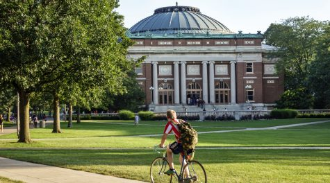 A student bikes across campus at the University of Illinois at Urbana-Champaign. (Jeffrey Greenberg/Universal Images Group via Getty Images)