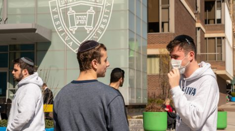 A Yeshiva University student wears a face mask on the grounds of the university in New York City, March 4, 2020.