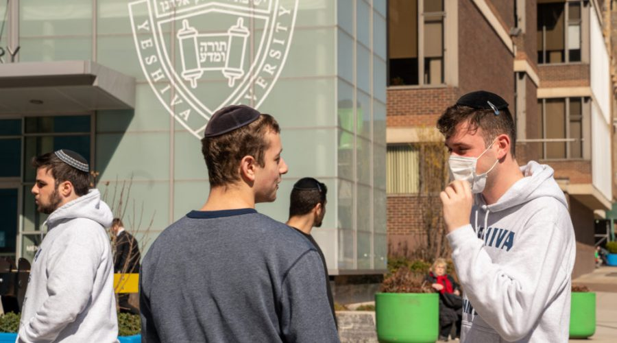 A+Yeshiva+University+student+wears+a+face+mask+on+the+grounds+of+the+university+in+New+York+City%2C+March+4%2C+2020.+