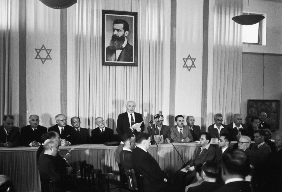 MAY 14 — David Ben-Gurion, Israel's first prime minister, reads the state's Declaration of Independence at the Tel Aviv Museum on May 14, 1948.