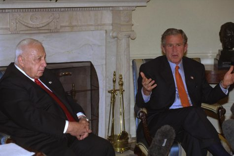 Before learning of the bombing in Rishon LeZion, Prime Minister Ariel Sharon and President George W. Bush meet at the White House on May 7, 2002, to discuss how to end the Second Intifada and make progress toward peace.
