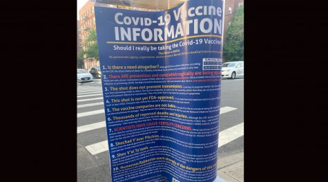 Flyers discouraging people from taking the COVID vaccines were posted in Midwood, a heavily Orthodox Jewish neighborhood in Brooklyn. (Luis Hernandez)