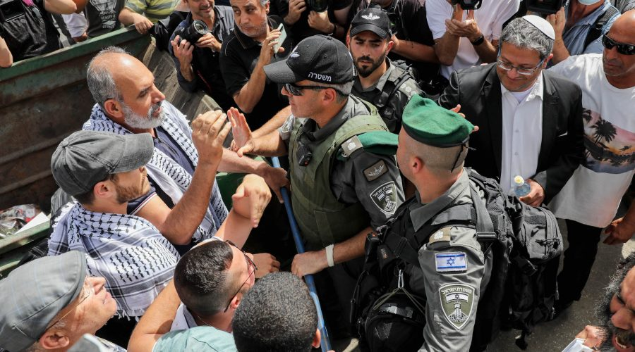 Israeli security forces clash with protesters during a protest against Israel's plan to evict Palestinians from the eastern Jerusalem neighborhood of Sheikh Jarrah on May 10, 2021. Itamar Ben-Gvir, a far-right Israeli lawmaker, is at right wearing a white kippah. (Olivier Fitoussi/Flash90)