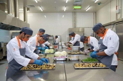 Kosher Arabia's team of chefs preparing food in their facility (Facebook)