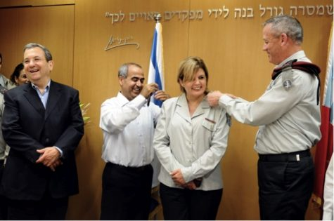 Orna Barbivai receives the insignia of her new rank of major general from her husband, Moshe, and IDF Chief of Staff Lt. Gen. Benny Gantz (right) on June 23, 2011. Defense Minister Ehud Barak, who announced her promotion, stands to the side.