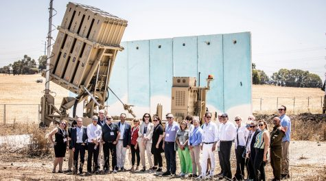 Members of the first solidarity mission of the Jewish Federations of North America in Israel after its May 2021 conflict with Hamas in Gaza visit an Iron Dome anti-rocket installation. (JFNA)