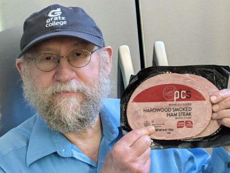 "Courtesy of Paul Finkelman  Paul Finkelman holds a package of ""kosher"" ham."