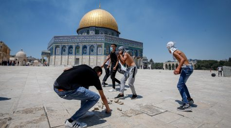 Palestinian worshippers gather rocks to throw at the Al-Aqsa mosque compound in Jerusalem