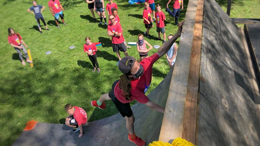 Jeff Baumgarten goes up the Warped Wall during the Jennifit fundraiser at Howdershell Park in May 2021