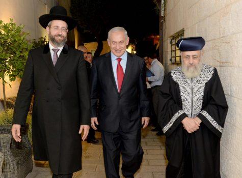 JULY 24: Chief Rabbis David Lau (left) and Yitzhak Yosef visit Prime Minister Benjamin Netanyahu at his sukkah in September 2013. Photo: Israeli Government Press Office