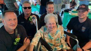 Lydia Motchan with Creve Coeur Fire Department Firefighters at her 100th birthday celebration July 10. Photo: Jennifer Feldman