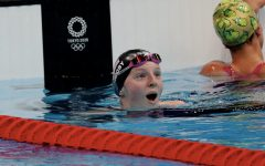 Lydia Jacoby of Team USA reacts with shock after winning the womens 100m breaststroke final at the Tokyo 2020 Olympics, July 26, 2021. (Xavier Laine/Getty)