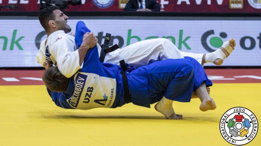 Iranian+judoka+Saeid+Mollaei+%28in+white%29+competes+at+the+International+Judo+Federation%E2%80%99s+Grand+Slam+in+Tel+Aviv.+Photo+by+Sabau+Gabriela%2FInternational+Judo+Federation