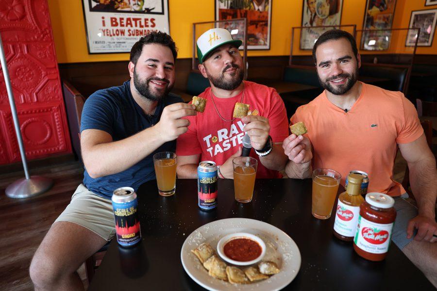 Jon, Jeff and Jacob Waldman taste the toasted ravioli at Pasta House for their T-Rav Tasters blog and video series.