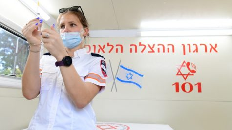 Israel begins offering Covid booster shots, but is it wise?