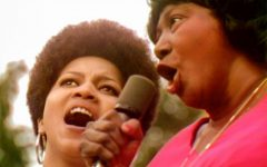 """Mavis Staples (left) and Mahalia Jackson sing 'Precious Lord' at the 1969 Harlem Cultural Festival in this image from the documentary """"Summer of Soul (...Or, When the Revolution Could Not Be Televised)."""" Photo: Searchlight Pictures"""