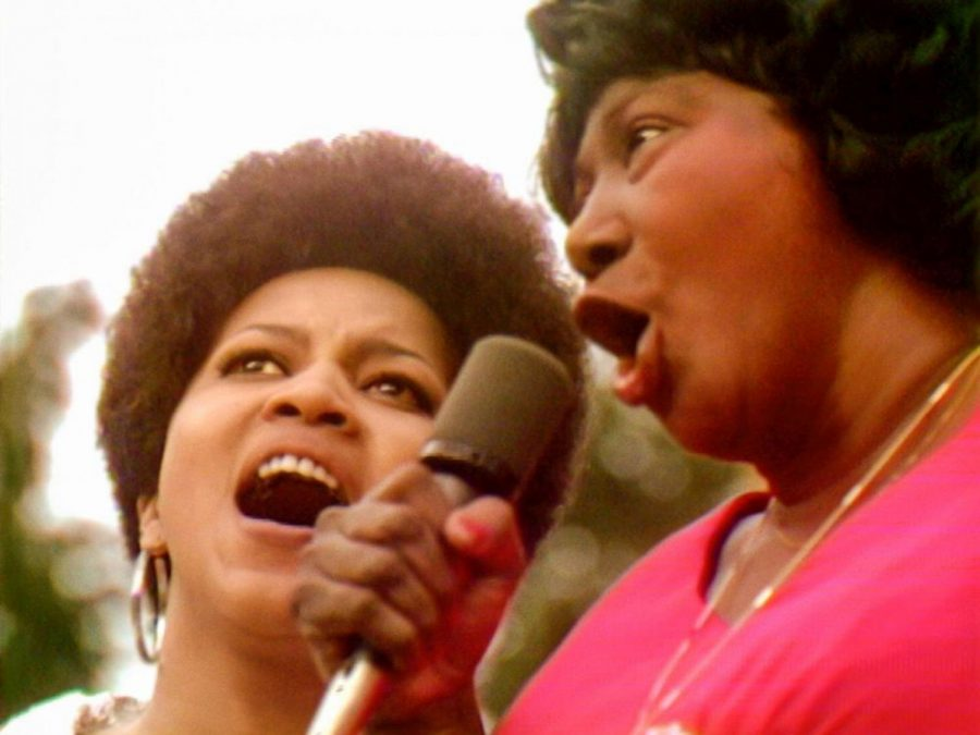 Mavis+Staples+%28left%29+and+Mahalia+Jackson+sing+%E2%80%98Precious+Lord%E2%80%99+at+the+1969+Harlem+Cultural+Festival+in+this+image+from+the+documentary+%E2%80%9CSummer+of+Soul+%28...Or%2C+When+the+Revolution+Could+Not+Be+Televised%29.%E2%80%9D+Photo%3A+Searchlight+Pictures