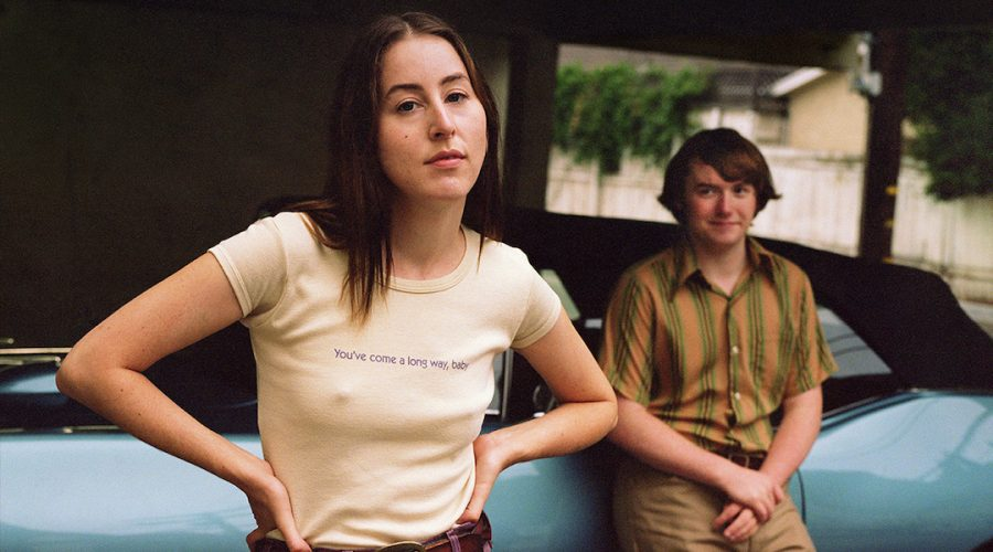 Alana+Haim+and+Cooper+Hoffman+in+a+promotional+poster+image+for+Licorice+Pizza.+%28MGM%29